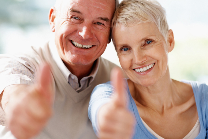 Bigstock-smiling-senior-couple-showing--6361896