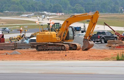 E._1291211-heavy-construction-equipment-working-on-an-airport-runway