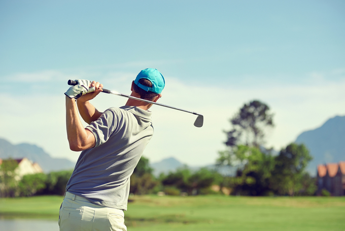 Bigstock-golfer-hitting-golf-shot-with--56440526