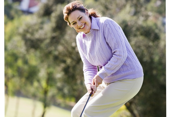 Cropped_5.4.14.-bigstock-woman-playing-a-game-of-golf-5637435