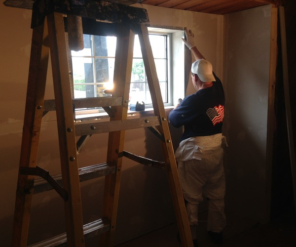 Tony_taping_window_area_middle_room